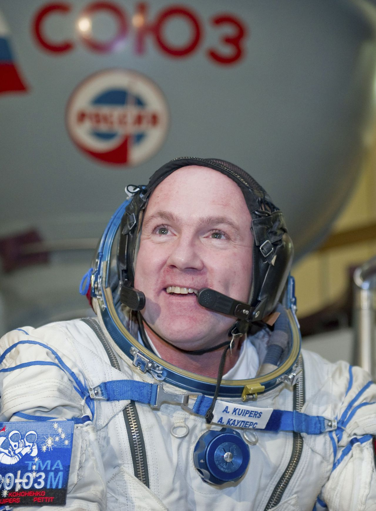 Dutch astronaut Andre Kuipers sits in a space suit before a training exercise at the Star City space centre outside Moscow November 30, 2011. Kuipers is part of a three-man team scheduled to fly to the International Space Station on December 21. REUTERS/Sergei Remezov (RUSSIA - Tags: TRANSPORT SCIENCE TECHNOLOGY SOCIETY HEADSHOT)