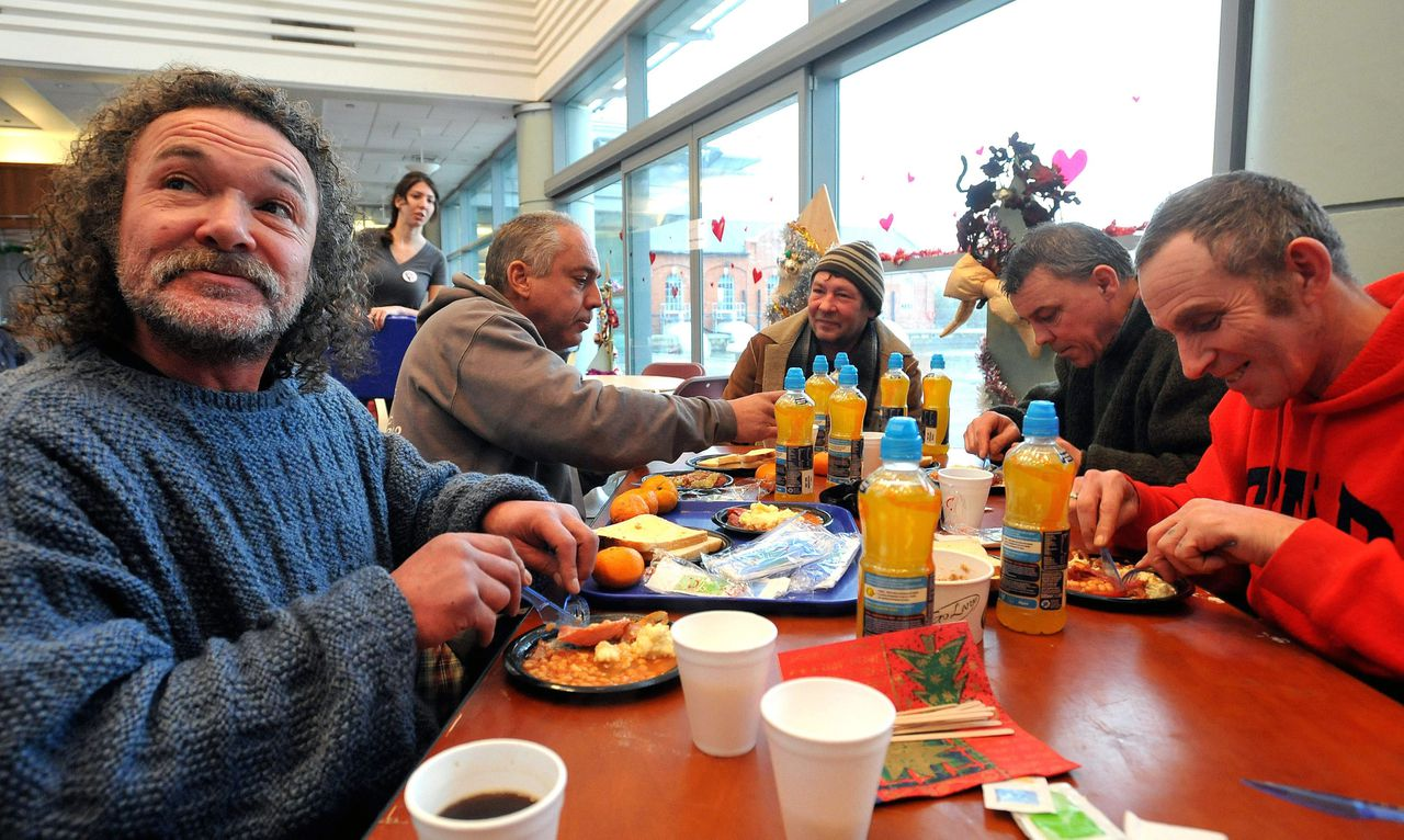 From left: Dave Camacho, Ron Winder, Polish Bernard, Paul Waldron and Dave Walker eat a hot cooked breakfast, at the Crisis at Christmas center for homeless people, in Docklands, east London, Thursday Dec. 23, 2010. The charity run center caters for some of London's homeless, with food, beds, healthcare and social meetings Dec. 23 - Dec. 30. (P Photo/John Stillwell/PA Wire) UNITED KINGDOM OUT NO SALES NO ARCHIVE