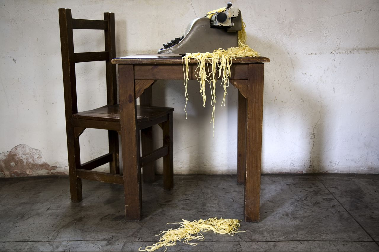 www.plainpicture.com, Noodles in type writer, Artistic, Author, Chair, Eating, Floor, Food, Hanging, Idea, Indoors, Literature, Nobody, Old-fashioned, Pasta, Rustic, Spaghetti, Staging, Still life, Table, Typewriter, Wood, Writing