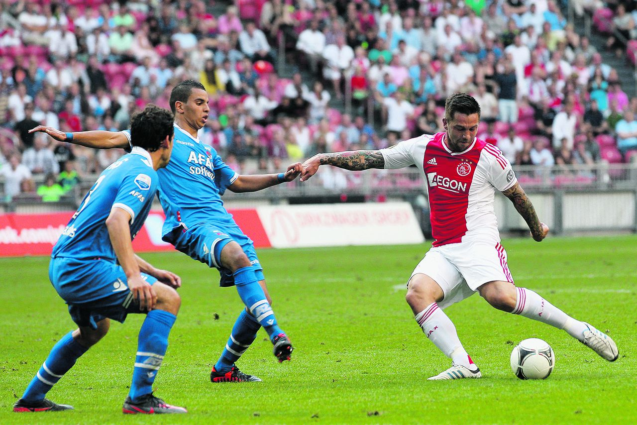 Onderwerp/Subject: Ajax - AZ Alkmaar - Eredivisie Reklame: Club/Team/Country: Seizoen/Season: 2012 FOTO/PHOTO: Theo JANSSEN (R) of Ajax in duel with Adam MAHER (L) of AZ Alkmaar. (Photo by PICS UNITED) Trefwoorden/Keywords: #04 $38 ±1341063607376 Photo- & Copyrights © PICS UNITED P.O. Box 7164 - 5605 BE EINDHOVEN (THE NETHERLANDS) Phone +31 (0)40 296 28 00 Fax +31 (0) 40 248 47 43 http://www.pics-united.com e-mail : sales@pics-united.com (If you would like to raise any issues regarding any aspects of products / service of PICS UNITED) or e-mail : sales@pics-united.com ATTENTIE: Publicatie ook bij aanbieding door derden is slechts toegestaan na verkregen toestemming van Pics United. VOLLEDIGE NAAMSVERMELDING IS VERPLICHT! (© PICS UNITED/Naam Fotograaf, zie veld 4 van de bestandsinfo 'credits') ATTENTION: © Pics United. Reproduction/publication of this photo by any parties is only permitted after authorisation is sought and obtained from PICS UNITED- THE NETHERLANDS