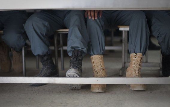 Afghan National Police men wait in their class room to get their certificate after their graduation ceremony in the German Police Training Center in Kunduz, Afghanistan, Thursday, Sept. 22. (AP Photo/Anja Niedringhaus)