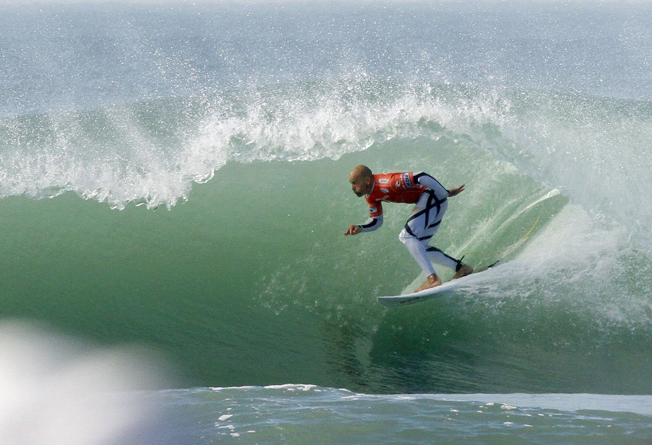Kelly Slater surfs under the curl at the Rip Curl Pro Search surf contest en route to winning the third round, thereby clinching his 11th ASP season title, at Ocean Beach on Wednesday, Nov. 2, 2011, in San Francisco. (AP Photo/George Nikitin)