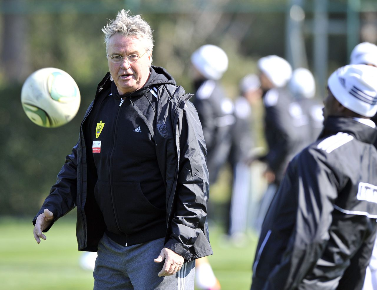 Dutch football coaching Guus Hiddink (L) stands during first training session with Anzhi Makhachkala's football team in Makhachkala on February 18, 2012. AFP PHOTO / SERGEI RASULOV JR.