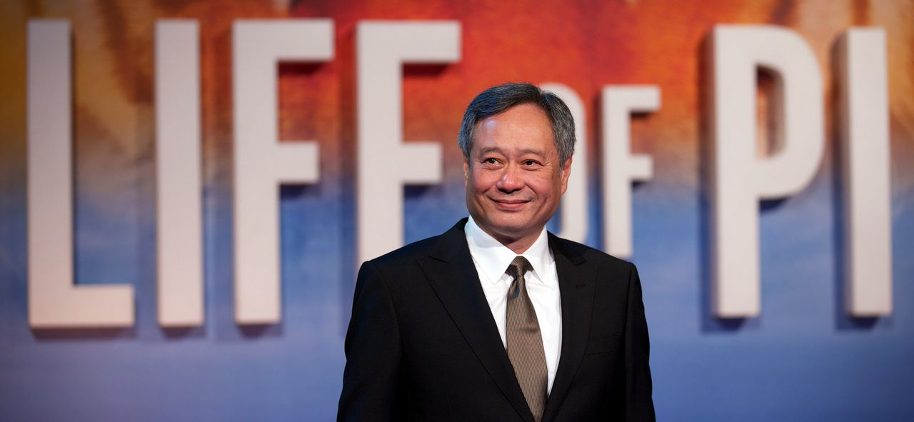 """Taiwanese-born American film director Ang Lee poses for pictures on the red carpet as he arrives for the UK premier of """"Life of Pi"""" at the Empire cinema, central London, on December 3, 2012. AFP PHOTO/ANDREW COWIE"""