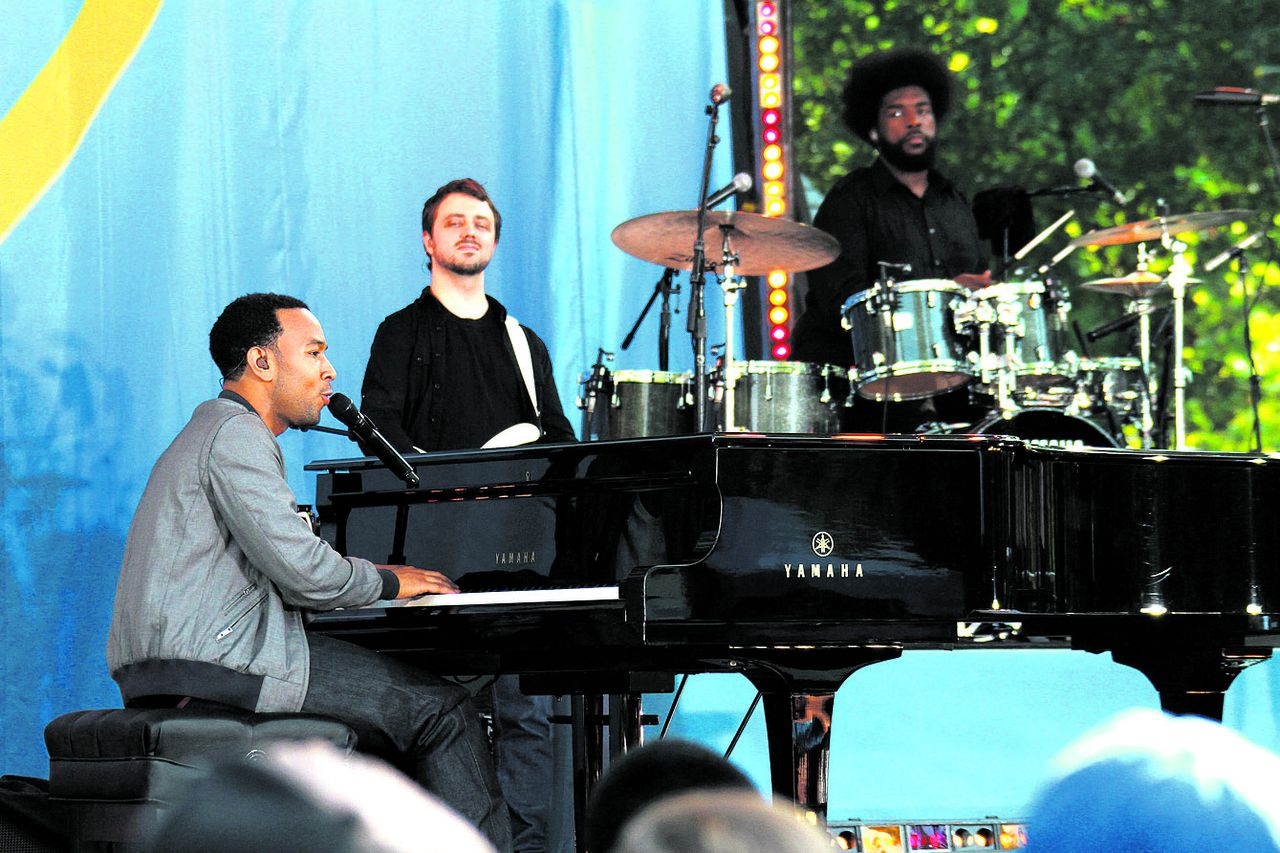 "John Legend and the Roots perform music from their new album ""Wake Up"" at Good Morning America's summer concert series in New York's Central Park, Friday, Aug. 6, 2010. (AP Photo/Rick Maiman)"