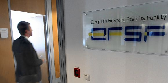 Caption: A man walks past at the entrance of the European Financial Stability Facility office in Luxembourg, Monday Oct. 3, 2011. After the Oct. 23 summit of EU leaders, the EFSF will wield massive financial power to contain the eurozone's debt troubles and keep them from plunging the global economy into another recession and putting thousands of people out of a job.(AP Photo/Yves Logghe)