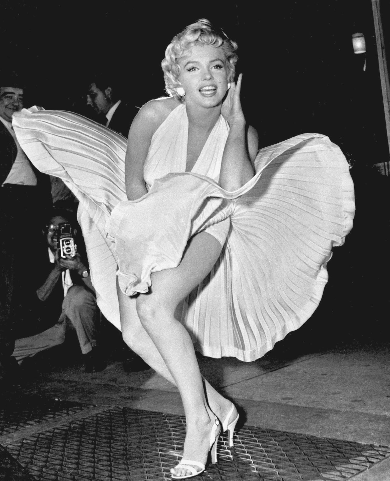 """** FILE ** In this Sept. 9, 1954 file photo, Marilyn Monroe poses over the updraft of a New York subway grating while in character for the filming of """"The Seven Year Itch"""" in New York. Julien's Auctions Hollywood Memorabilia is auctioning off Marilyn Monroe memorabilia, including personal photos, bank statements, scripts, signed checks, and the chair used in the star's final photo shoot, on Saturday, June 26, 2010, and Sunday June 27 at Planet Hollywood Resort and Casino in Las Vegas.(AP Photo/Matty Zimmerman, file)"""