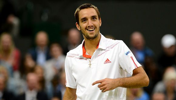 Caption: Serbia's Viktor Troicki reacts to a shout in the crowd during his fourth round men's singles match against Serbia's Novak Djokovic on day seven of the 2012 Wimbledon Championships tennis tournament at the All England Tennis Club in Wimbledon, southwest London, on July 2, 2012. AFP PHOTO / ANDREW YATES RESTRICTED TO EDITORIAL USE