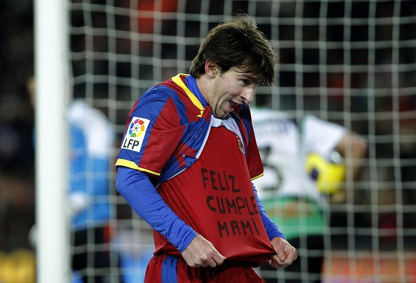 "FC Barcelona's Lionel Messi from Argentina celebrates his goal as he shows a sentence on his undershirt reading ""happy birthday mummy"" during the Spanish La Liga soccer match against Racing Santander at the Camp Nou stadium in Barcelona, Spain, Saturday, Jan. 22, 2011. (AP Photo/Emilio Morenatti)"