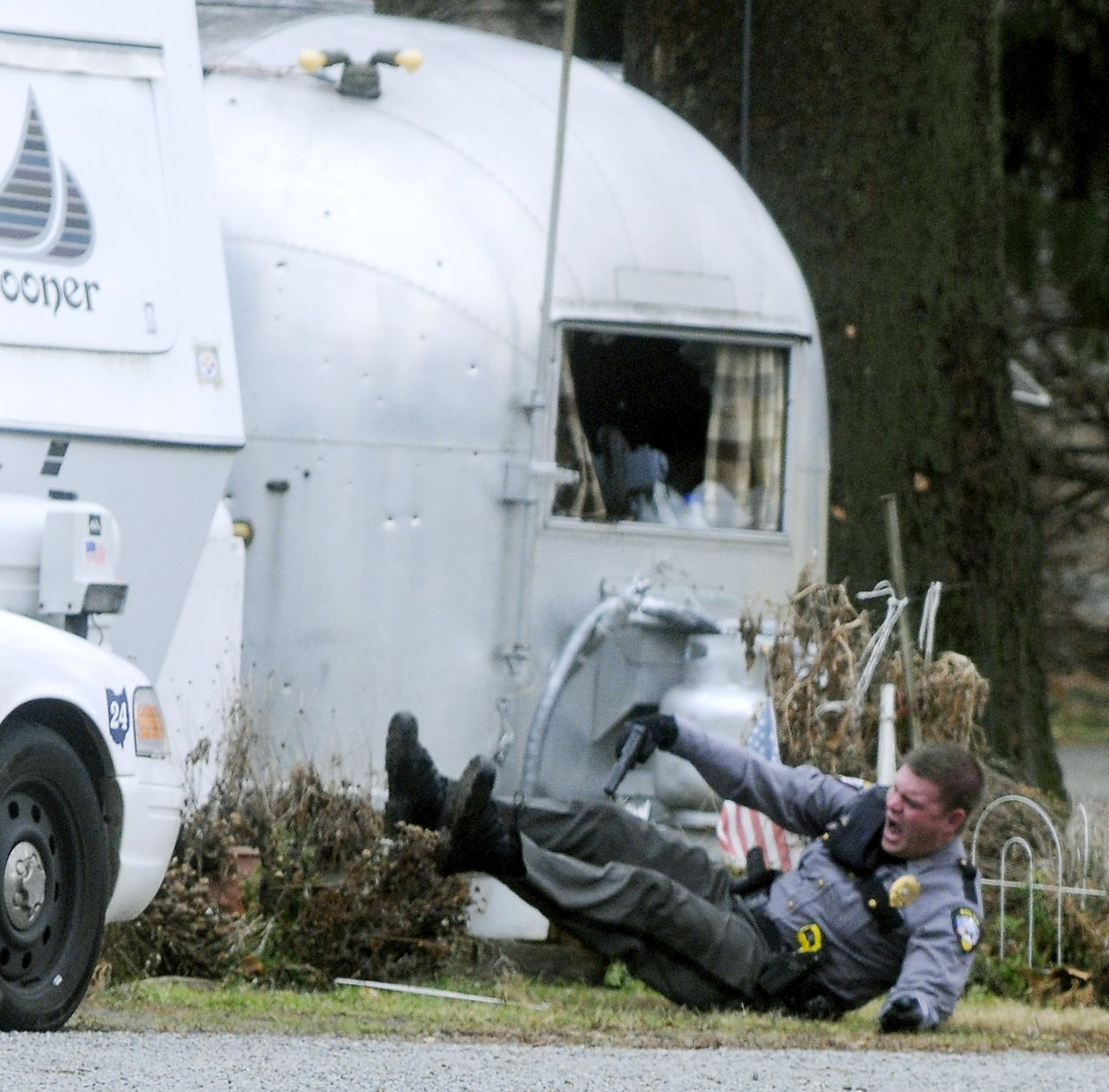German Township Patrolman Jeremy Blum is wounded in a police shootout with a gunman at Enon Beach trailer park near Enon, Ohio, Saturday, Jan. 1, 2011. Blum was shot in the arm and shoulder, and taken to Miami Valley Hospital, where he is in stable condition, according to German Township Police Chief William Dickerson, as reported by the Springfield News-Sun. (AP Photo/Springfield News-Sun, Marshall Gorby)
