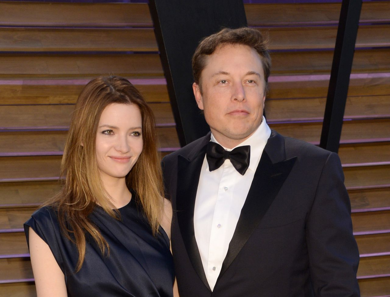 FILE - In this March 2, 2014 file photo, Talulah Riley, left, and Elon Musk attend the 2014 Vanity Fair Oscar Party, in West Hollywood, Calif. Musk and his wife are divorcing for a second time. The entrepreneur and his wife, Riley, issued a joint statement Wednesday, Dec. 31, 2014, announcing they are splitting amicably after they remarried in July 2013 following their previous breakup. (Photo by Evan Agostini/Invision/AP, File)