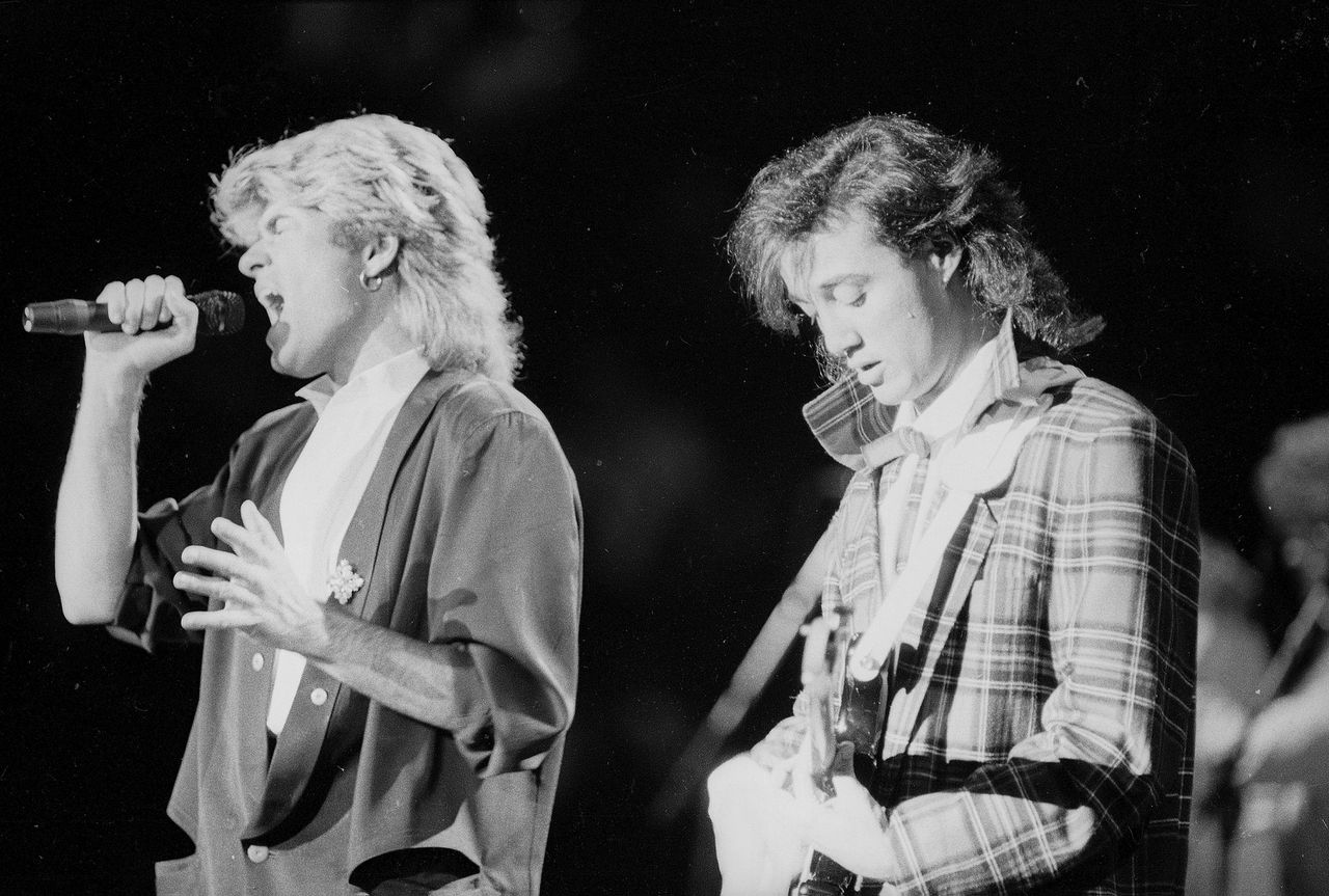 The pop duo Wham! performs in Peking before a capacity audience of Chinese and foreign fans, April 7, 1985. Singers George Michael, left, and Andrew Ridgeley, had youthful fans on their feet despite police warnings to sit down. (AP Photo/Neal Ulevich)