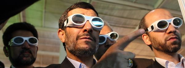 Iranian President Mahmoud Ahmadinejad tours an exhibition on laser technology in Tehran on February 7, 2010. Ahmadinejad ordered Iran's atomic chief to enrich uranium to 20 percent, in a fresh challenge to world powers days after appearing to accept a UN-drafted nuclear fuel deal. AFP PHOTO/ATTA KENARE