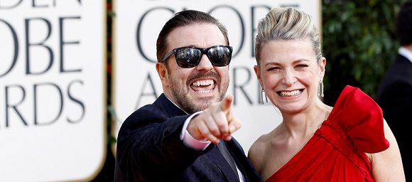 Caption: Comedian Ricky Gervais and partner Jane Fallon arrive at the 68th annual Golden Globe Awards in Beverly Hills, California, in this January 16, 2011 file photograph. Golden Globe organizers on November 16, 2011 said they have hired British comedian Gervais to host the upcoming film and TV honors for the third time, even after his performance earlier this year offended many top celebrities. REUTERS/Mario Anzuoni/Files (UNITED STATES - Tags: ENTERTAINMENT PROFILE)