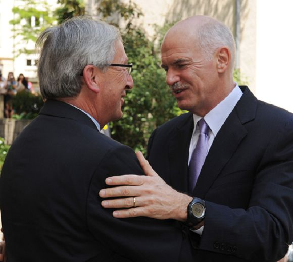 Caption: Luxembourg Prime Minister and Eurogroup president Jean-Claude Juncker (R) welcomes Greek Prime Minister George Papandreou prior their working meeting on June 3, 2011 at the State Ministry bulding in Luxembourg. The head of eurozone finance ministers, Luxembourg Prime Minister Jean-Claude Juncker, meets with Greek Prime Minister George Papandreou amid growing expectations Athens will need a new bailout. AFP PHOTO / GEORGES GOBET