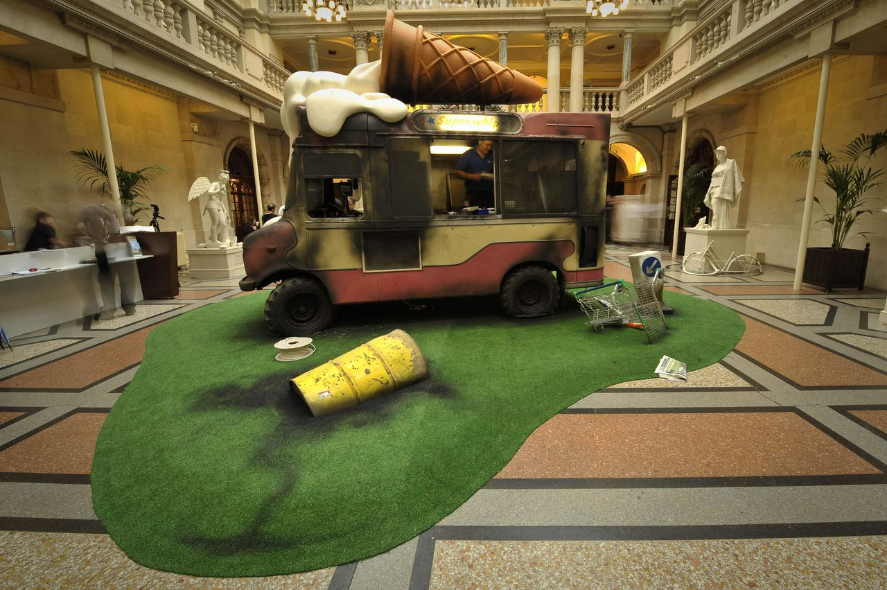 An installation art piece by Banksy showing a wrecked and graffiti strewn icecream van installed at Bristol Museum, in Bristo, England, where the infamous artist is exhibiting many of his works, Friday June 12, 2009. (AP Photo / Ben Birchall, PA) ** UNITED KINGDOM OUT - NO SALES - NO ARCHIVES **