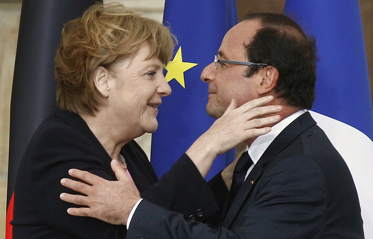France's President Francois Hollande (R) and Germany's Chancellor Angela Merkel embrace after their speeches during the 50th anniversary ceremony of the reconciliation meeting between France's President Charles de Gaulle and Germany's Chancellor Konrad Adenauer after World War II, in Reims July 8, 2012. REUTERS/Jacky Naegelen (FRANCE - Tags: POLITICS ANNIVERSARY TPX IMAGES OF THE DAY)