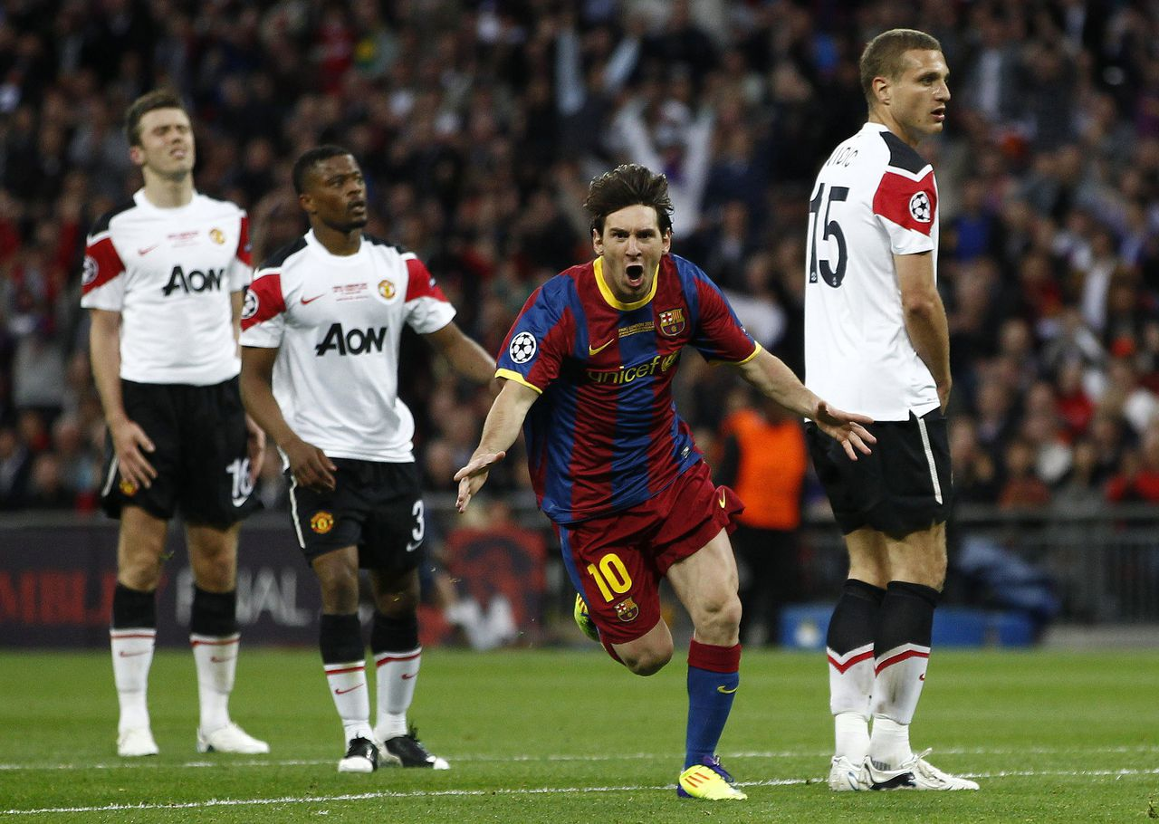 RNPS IMAGES OF THE YEAR 2011 - Barcelona's Lionel Messi celebrates after scoring against Manchester United during their Champions League final soccer match at Wembley Stadium in London May 28, 2011. REUTERS/Eddie Keogh (BRITAIN - Tags: SPORT SOCCER)