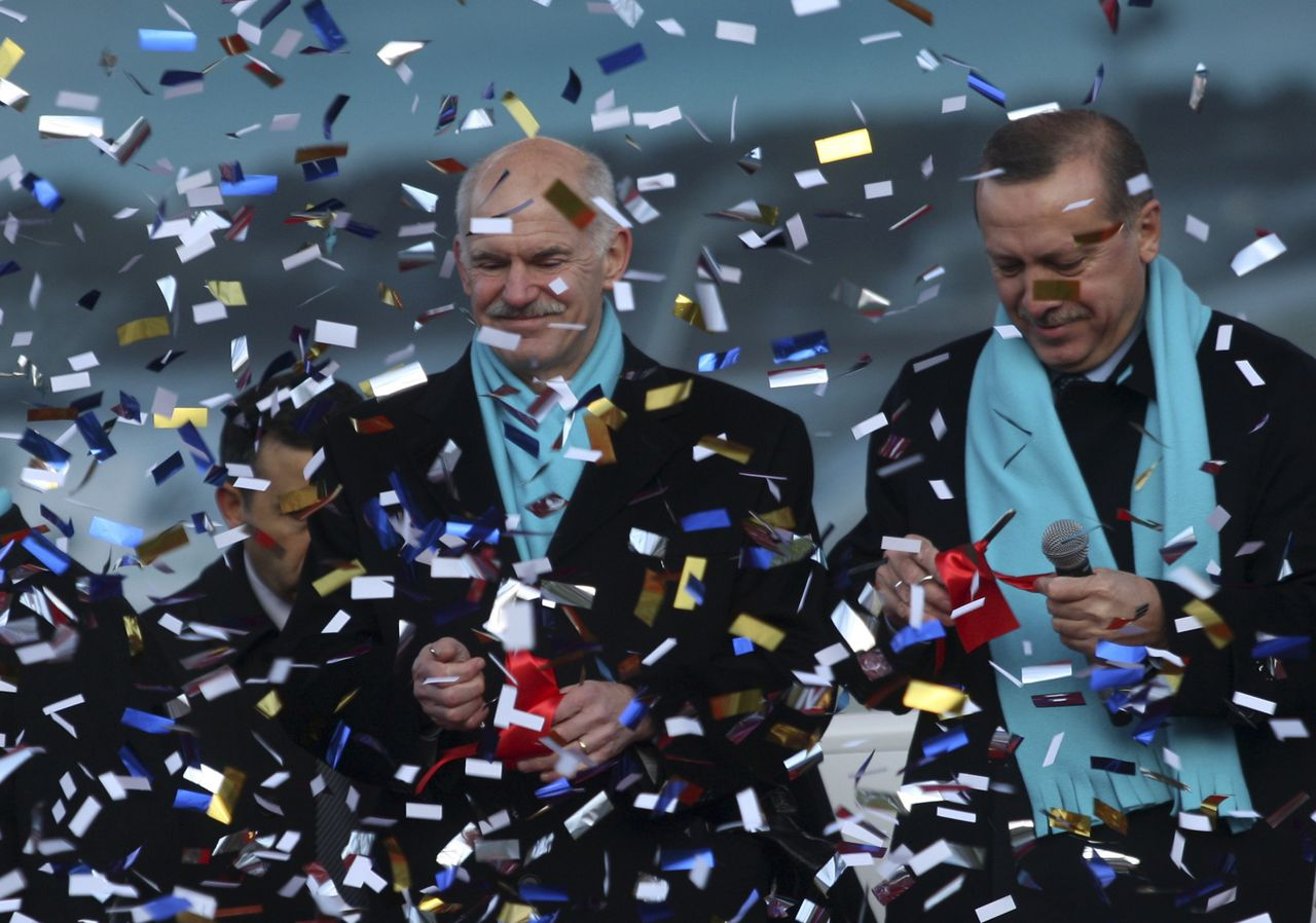 Confetti falls on Turkey's Prime Minister Tayyip Erdogan and his Greek counterpart George Papandreou (L) during a ceremony at Cemal Gursel stadium in Erzurum, eastern Turkey, January 7, 2011. Papandreou and Erdogan are in Erzurum to participate in the Turkish ambassadors summit. REUTERS/Stringer (TURKEY - Tags: POLITICS)