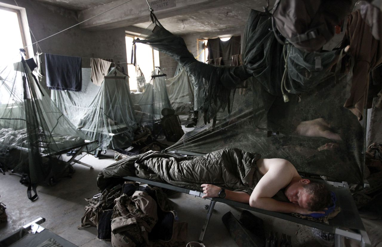 German Bundeswehr army soldiers with the 3rd company of the Quick Reaction Force (QRF) sleep in a combat outpost in Chahar Dara district on the outskirts of Kunduz, northern Afghanistan, May 12, 2010. REUTERS/Fabrizio Bensch (AFGHANISTAN - Tags: MILITARY CONFLICT)