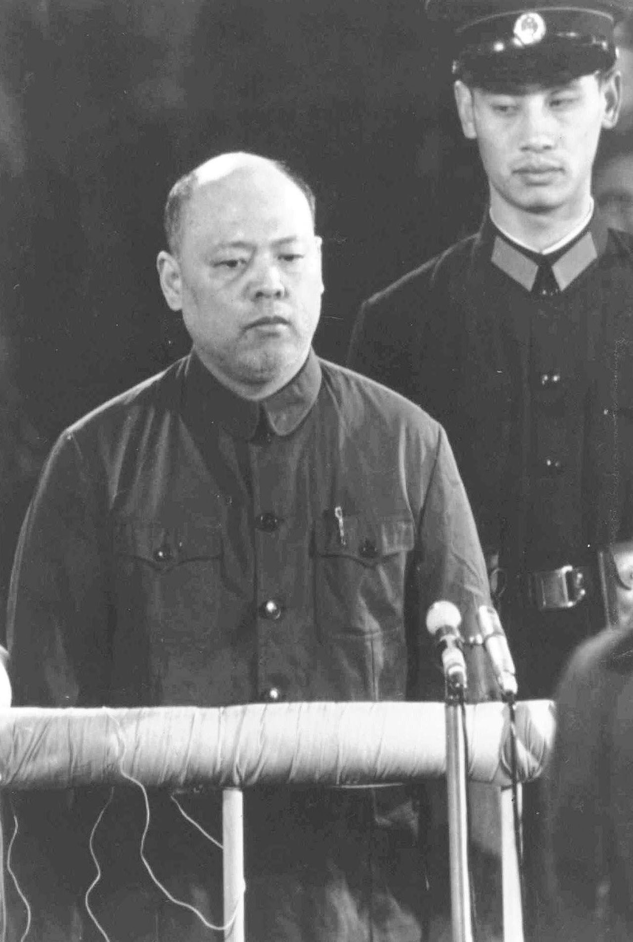 """** FILE ** Yao Wenyuan is shown in this Nov. 20, 1980 file photo standing at the dock during trials for the """"Gang of Four"""" in Beijing. Yao, known as China's killer with a pen for his role as the propaganda chief in the group which led the excesses of the 1966-1976 """"Cultural Revolution"""", died of diabetes on Dec. 23, 2005, the official Xinhua News Agency reported in Beijing, China Friday Jan. 6, 2006. (AP Photo/Xinhua FILE)"""