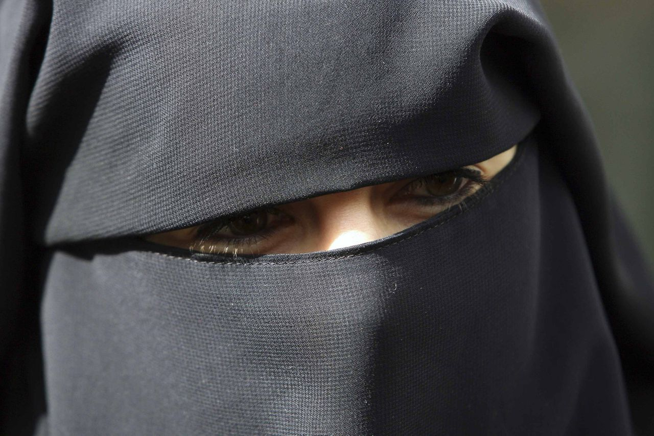 "Anne, an assumed name of 31-year old French woman who has been fined for wearing a niqab while driving, speaks to the media during a news conference with her husband Lies Hebbadj in Nantes, western France, April 26, 2010. She told French media on Friday that police stopped her last month while she was driving in the city of Nantes, near the French Atlantic coast, and handed her a 22-euro ($29.6) fine, saying her veil posed a ""safety risk"" to her driving. REUTERS/Stephane Mahe (FRANCE - Tags: SOCIETY POLITICS RELIGION HEADSHOT)"
