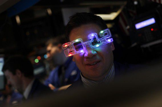 "Robert Tuccillo of Barclays Capital wears ""2012"" glasses on the main trading floor of the New York Stock Exchange during the final trading day of 2011 in New York December 30, 2011. REUTERS/Mike Segar (UNITED STATES - Tags: BUSINESS SOCIETY)"