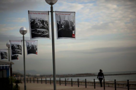 Electoral banners with an image of presidential candidate of Socialism Catalan Party, Carma Chacon, are seen along a promenade in Barcelona city, Spain, Sunday Nov. 13, 2011. Another troubled European government will almost surely tumble this weekend as Spanish voters braving sky-high unemployment, the sting of austerity, piles of debt and a bleak future are expected to dump the ruling Socialists and hand their national mess to opposition conservatives. Polls point to a crushing win on Sunday and perhaps even a huge majority in Parliament for the Popular Party led by Mariano Rajoy. (AP Photo/Emilio Morenatti)