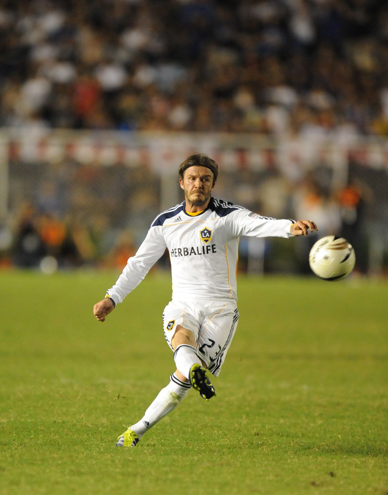 David Beckham of the Los Angeles Galaxy kicks the during their friendly football match against the Philippines' Azkals at the Rizal memorial stadium in Manila on December 3, 2011. LA Galaxy won 6-1. PHOTO/TED ALJIBE