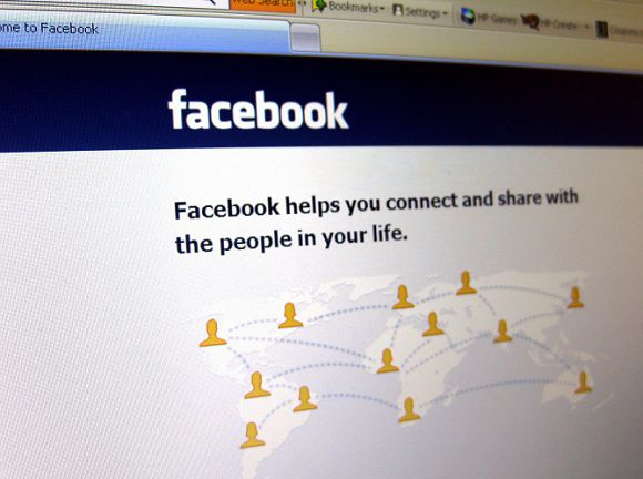 Caption: This June 20, 2012 photo shows a Facebook login page on a computer screen in Oakland, N.J. Facebook is expected to report their quarterly financial results after the market closes on Thursday, July 26, 2012. (AP Photo/Stace Maude)