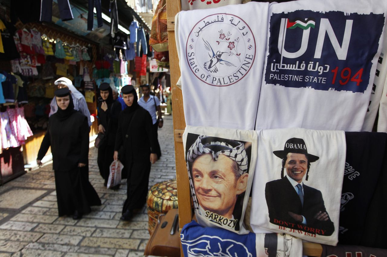 Shirts with the images of U.S. President Barack Obama and France's President Nicolas Sarkozy and State of Palestine shirts are displayed for sale in a market in Jerusalem's Old City September 18, 2011, ahead of the Palestinians' bid for statehood at the United Nations on Friday. REUTERS/Ammar Awad (JERUSALEM - Tags: POLITICS RELIGION)