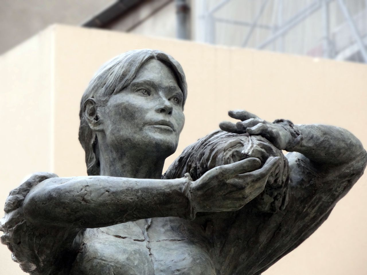"""A handout photo released by the Ville de Nogent-sur-Marne in France shows the 'Valnurese' sculpture by French artist Elisabeth Cibot as it is erected in Nogent-sur-Marne on July 31, 2012. The sculpture, an effigy of former French first lady Carla Bruni-Sarkozy dressed in workwear is dedicated to the Italian women labourers working in the town since 1860. AFP PHOTO/HO/Ville de Nogent-sur-Marne ---RESTRICTED TO EDITORIAL USE - MANDATORY CREDIT """"AFP PHOTO / HO / Ville de Nogent-sur-Marne"""" - NO MARKETING NO ADVERTISING CAMPAIGNS - DISTRIBUTED AS A SERVICE TO CLIENTS---"""