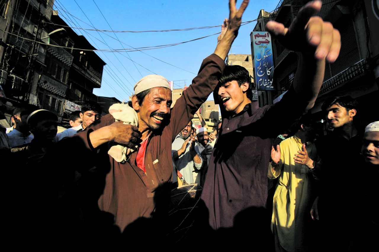 Pakistani men, dance celebrating the dismissal of Prime Minister Yousuf Raza Gilani in Peshawar, Pakistan, Tuesday, June 19, 2012. Pakistan's top court ruled Tuesday that Gilani was no longer eligible to hold office due to an earlier contempt conviction, ushering in fresh political turmoil in the nuclear-armed country. (AP Photo/Mohammad Sajjad)