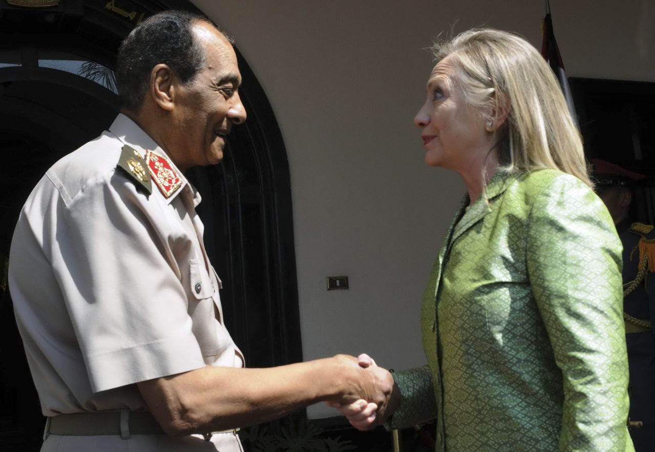 Egyptian military chief Field Marshal Mohamed Hussein Tantawi (L) shakes hand with U.S. Secretary of State Hillary Clinton before their meeting at the Defence Ministry in Cairo July 15, 2012. Hundreds of people chanted anti-U.S. and anti-Islamist slogans outside Clinton's hotel on Saturday as the U.S. secretary of state urged Egypt's military and Muslim Brotherhood to complete a transition to full democratic rule. REUTERS/U.S Embassy Media Office/Handout (EGYPT - Tags: POLITICS MILITARY TPX IMAGES OF THE DAY) FOR EDITORIAL USE ONLY. NOT FOR SALE FOR MARKETING OR ADVERTISING CAMPAIGNS. THIS IMAGE HAS BEEN SUPPLIED BY A THIRD PARTY. IT IS DISTRIBUTED, EXACTLY AS RECEIVED BY REUTERS, AS A SERVICE TO CLIENTS