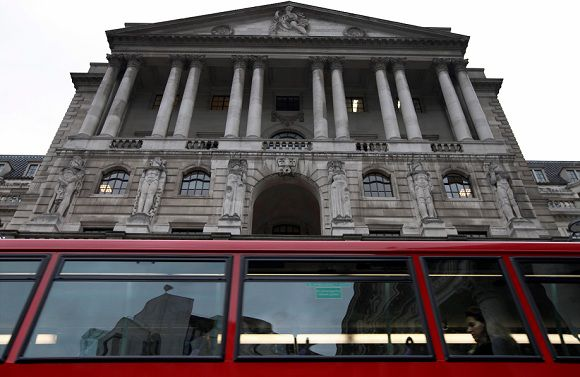 Caption: A bus is driven past the Bank of England, in London's City financial district, Thursday, Nov. 3, 2011. European stocks gained Thursday amid mounting expectations that a Greek referendum on a European bailout plan will be abandoned. Britain's FTSE 100 swung between gains and losses before edging up 0.5 percent to 5,510. (AP Photo/Lefteris Pitarakis)