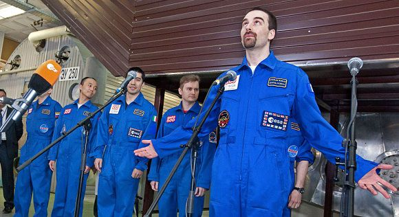 "Caption: A pool photo released by Moscow's Institute for Medical and Biological Problems on November 4, 2011, shows the six members of the Mars500 crew posing after they emerged from the Mars500 isolation facility in Moscow. Six volunteers emerged today from isolation after spending almost one-and-a-half-years locked away from the world at a Russian research centre to test the effects on humans of a flight to Mars. The unprecedented experiment has simulated the duration and isolation of a return journey to the Red Planet, even including ""walks"" on a replica of the Martian surface and 20-minute time gaps in communication with outside.AFP-PHOTO/ MOSCOW'S INSTITUTE FOR MEDICAL AND BIOLOGICAL PROBLEMS/POOL/ OLEG VOLOSHIN"