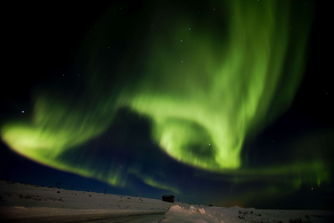 AFP PICTURES OF THE YEAR 2011 Aurora borealis, or northern lights, fill the sky on March 13, 2011 over Finnmark during the 1,000 kms Finnmarksloepet, the world?s northernmost sled dog race, in Finnmark county in northern Norway. AFP PHOTO / TORE MEEK - NORWAY OUT -