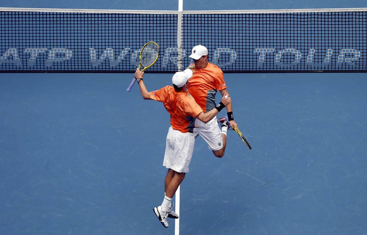 Bob Bryan and Mike Bryan of the U.S. jump as they celebrate winning the men's doubles final against Argentina's Carlos Berlocq and Uzbekistan's Denis Istomin at the China Open tennis tournament in Beijing October 7, 2012. REUTERS/David Gray (CHINA - Tags: SPORT TENNIS TPX IMAGES OF THE DAY)