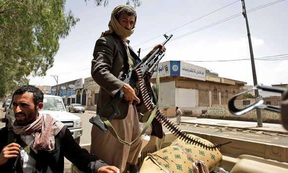 Caption: Armed Yemeni tribesmen stand guard in a street in Sanaa, Yemen, Sunday, May 29, 2011. With diplomatic efforts stalled, the political crisis gave way to serious street battles last week between Saleh's forces and armed men loyal to one of the country's most powerful tribal leaders, who has turned against the president. The clashes killed 124 people and raised fears of a civil war before the two sides reached a cease-fire agreement over the weekend. (AP Photo/Hani Mohammed)