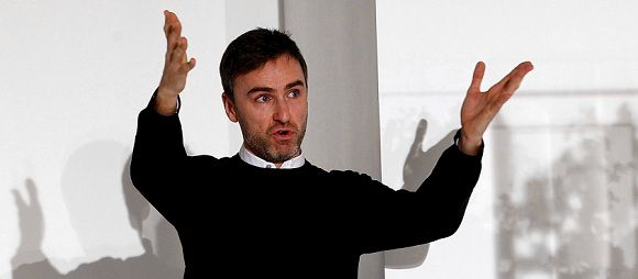 Caption: FILE - Belgian designer Raf Simons acknowledges the applause of the audience at the end of the Jil Sander Spring/Summer 2012 women's collection in Milan, in this Saturday, Sept. 25, 2011 file photo. Christian Dior on Monday April 9 2012 named Belgian designer Simons as its new artistic director, and says he'll present his first show for the renowned fashion house in Paris in July. The appointment comes seven months after star designer John Galliano was convicted by a Paris court for making anti-Semitic insults. (AP Photo/Giuseppe Aresu, file)