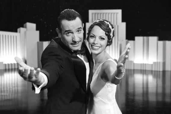 "Actors Jean Dujardin (L) plays George Valentin and Berenice Bejo plays Peppy Miller in a scene from the film ""The Artist"" in this undated publicity photograph released to Reuters December 15, 2011. Silent movie ""The Artist"" painted a pretty picture at the Golden Globe nominations on Thursday, leading all movies with six nods including best film comedy or musical in the race to Hollywood's Oscars. REUTERS/Courtesy The Weinstein Company/Handout (UNITED STATES - Tags: ENTERTAINMENT) NO SALES. NO ARCHIVES. FOR EDITORIAL USE ONLY. NOT FOR SALE FOR MARKETING OR ADVERTISING CAMPAIGNS. THIS IMAGE HAS BEEN SUPPLIED BY A THIRD PARTY. IT IS DISTRIBUTED, EXACTLY AS RECEIVED BY REUTERS, AS A SERVICE TO CLIENTS"