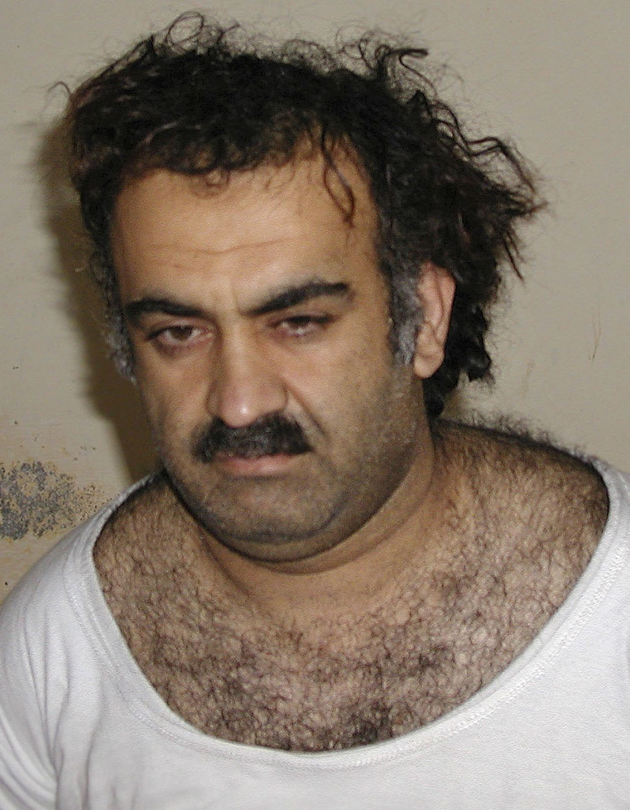 Khalid Sheikh Mohammed FILE - In this March 1, 2003 file photo, Khalid Sheikh Mohammed is seen shortly after his capture during a raid in Pakistan. The results of the Pearl Project, an investigation carried out by a team of American journalists and students and spanning more than three years, raise troubling questions about Pakistan's dysfunctional criminal justice system and underscore the limits U.S. officials face in relying on Pakistani authorities. (AP Photo/File)