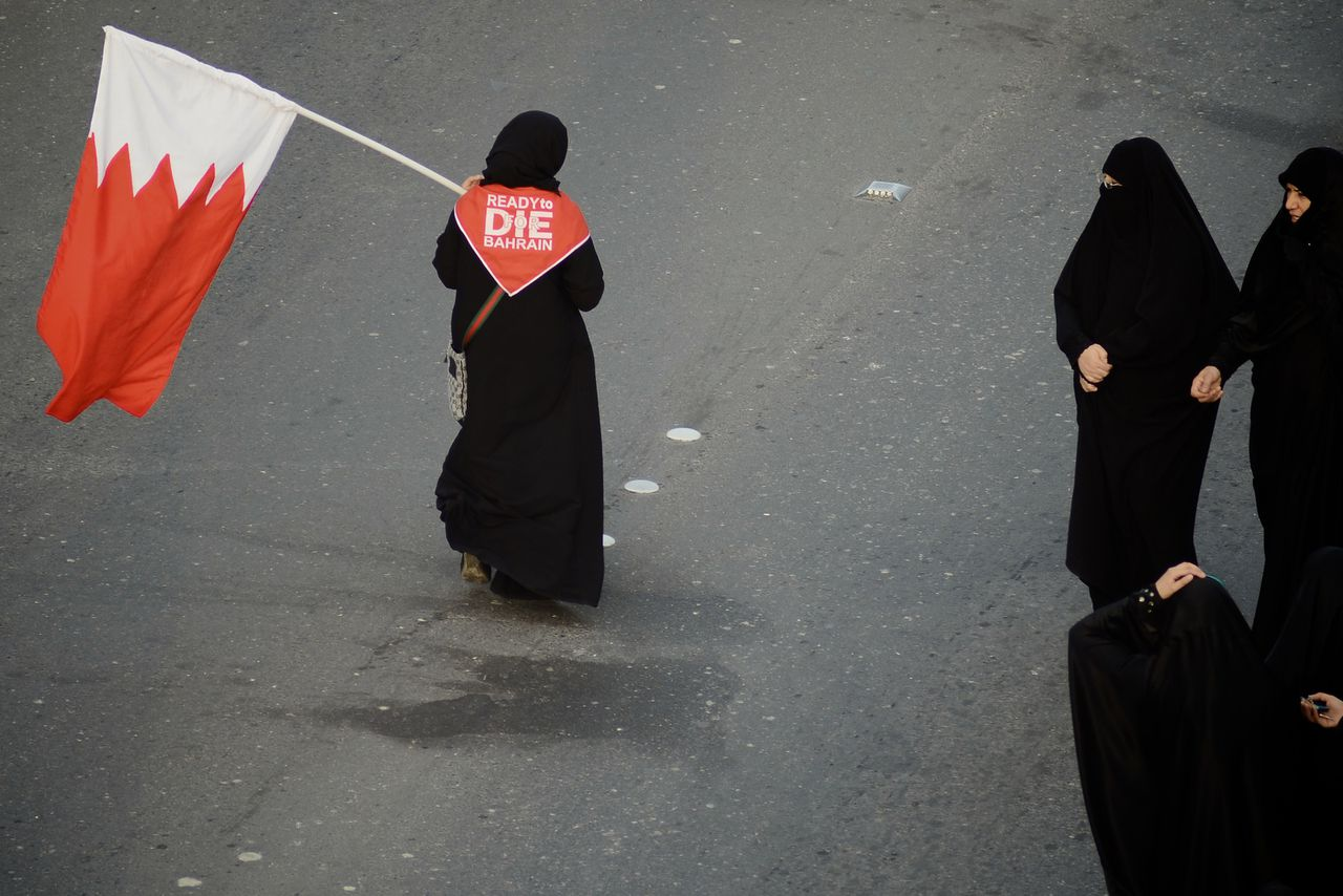 Bahraini Shiite Muslims take part in an anti-government rally in Bilad al-Kadim, a suburb of Manama, on February 24, 2012. A month-long Shiite-led pro-democracy protests were bloodily crushed last year by the kingdom's Sunni minority rulers with the help of a Saudi-led military intervention. AFP PHOTO/STR == BAHRAIN OUT ==