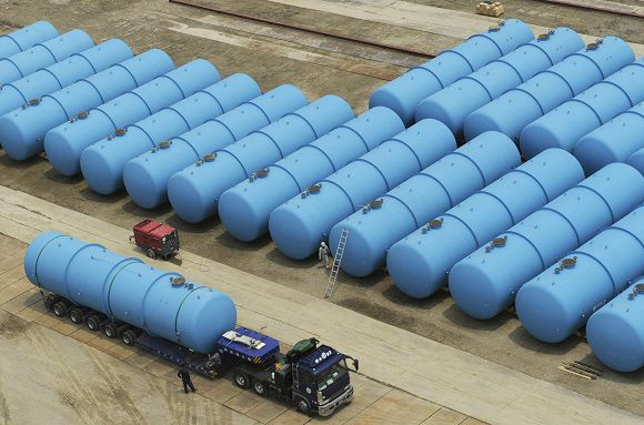 Steel tanks, each with a capacity of 100 or 120 tonness, to be used to store radioactive wastewater that is accumulating at Tokyo Electric Power Co.(TEPCO)'s Fukushima Daiichi nuclear power plant, are being transferred by a trailer from a factory in Kanuma, north of Tokyo June 5, 2011. TEOCO said on Friday that more radioactive water could begin spilling into the sea later this month if there is a glitch in setting up a new decontamination system. Managing the growing pools of radioactive water is a major challenge with the start of Japan's monthlong rainy season, and the plant, on the Pacific coast 240 km (150 miles) north of Tokyo, is running out of storage space. REUTERS/Kyodo (JAPAN - Tags: DISASTER) FOR EDITORIAL USE ONLY. NOT FOR SALE FOR MARKETING OR ADVERTISING CAMPAIGNS. THIS IMAGE HAS BEEN SUPPLIED BY A THIRD PARTY. IT IS DISTRIBUTED, EXACTLY AS RECEIVED BY REUTERS, AS A SERVICE TO CLIENTS. MANDATORY CREDIT. JAPAN OUT. NO COMMERCIAL OR EDITORIAL SALES IN JAPAN. YES