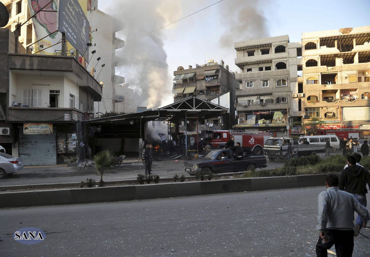 A crowd gathers at the site of a blast in Jaramana district, near Damascus, in this handout photograph released by Syria's national news agency SANA November 28, 2012. At least 34 people were killed in explosions which struck the eastern Damascus district of Jaramana on Wednesday, state television said, quoting a source at the Interior Ministry. It said 10 bags containing the remains of unidentified victims had also been collected. Eighty-three people were seriously wounded, it said. REUTERS/Sana (SYRIA - Tags: CONFLICT CIVIL UNREST) FOR EDITORIAL USE ONLY. NOT FOR SALE FOR MARKETING OR ADVERTISING CAMPAIGNS. THIS IMAGE HAS BEEN SUPPLIED BY A THIRD PARTY. IT IS DISTRIBUTED, EXACTLY AS RECEIVED BY REUTERS, AS A SERVICE TO CLIENTS