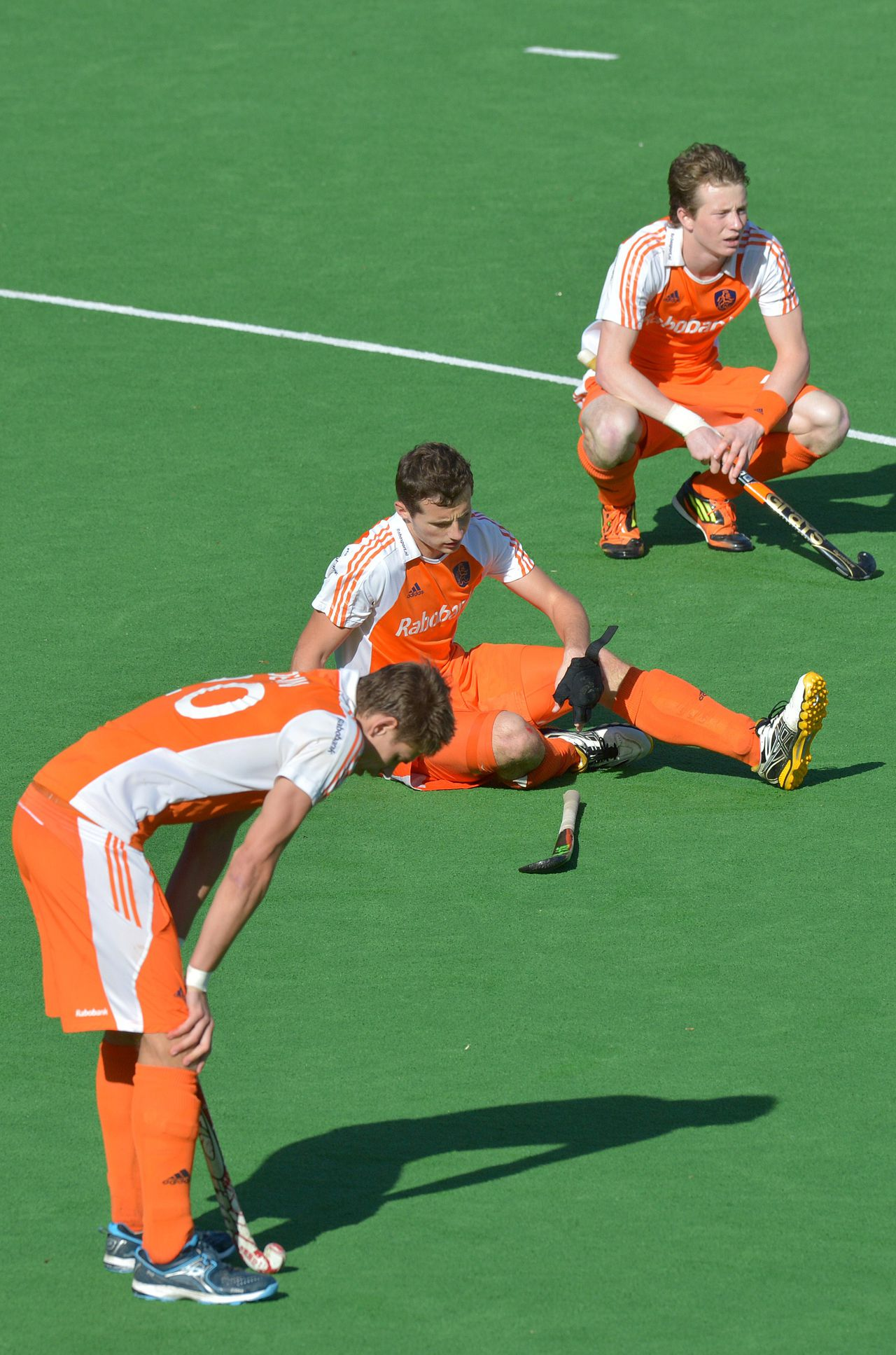 Sander de Wijn (L), Sander Baart (C) and Seve van Ass of the Netherlands react after Australia scored a golden goal in extra time in the gold medal match to win the men's Hockey Champions Trophy tournament in Melbourne on December 9, 2012. Australia won the match 2-1 in extra time. IMAGE STRICTLY RESTRICTED TO EDITORIAL USE - STRICTLY NO COMMERCIAL USE AFP PHOTO/Paul CROCK