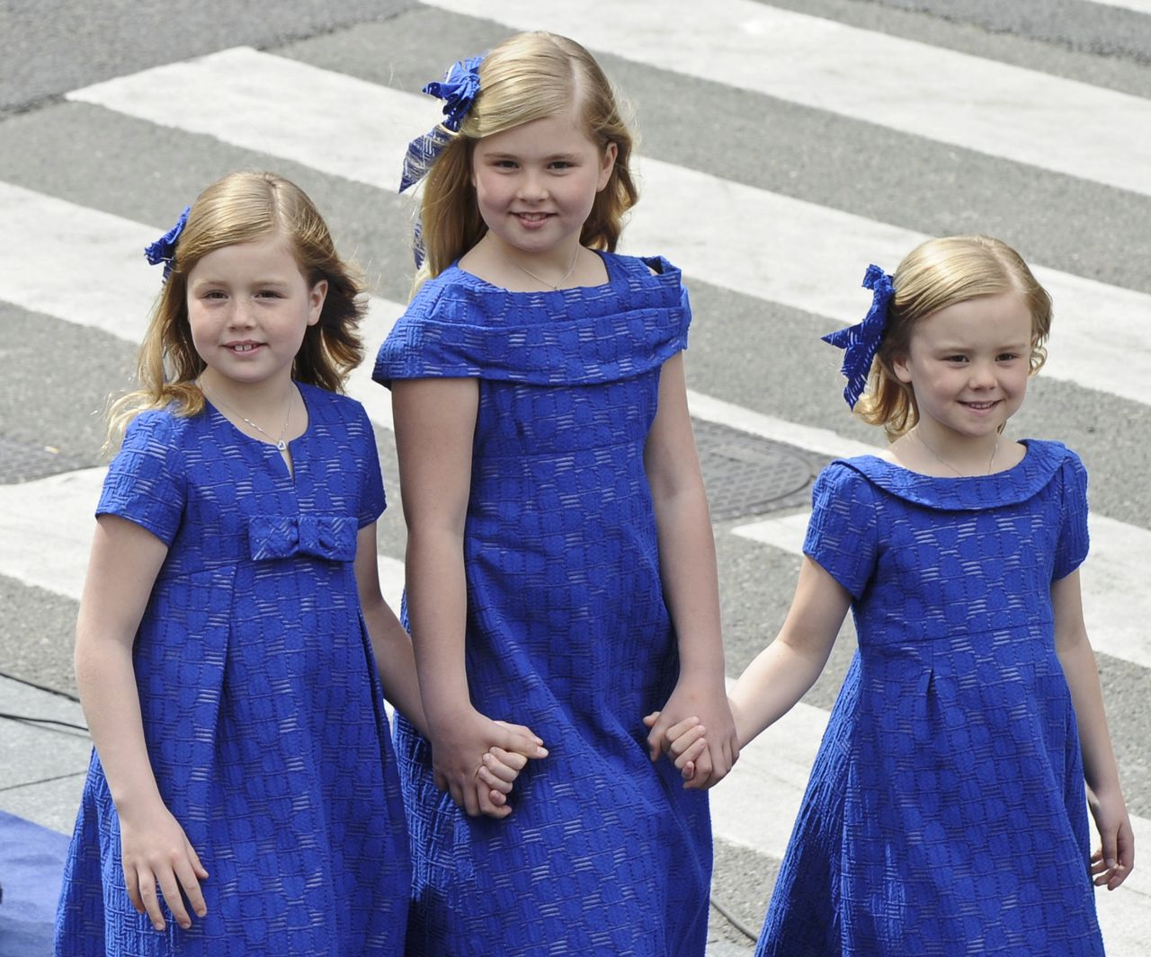 Crown Princess Catharina-Amalia (C) Princess Alexia (L) and Princess Ariane arrive to attend the inauguration at Nieuwe Kerk church in Amsterdam April 30, 2013. The Netherlands is celebrating Queen's Day on Tuesday, which will also mark the abdication of Queen Beatrix and the investiture of her eldest son Willem-Alexander. REUTERS/Paul Vreeker (NETHERLANDS - Tags: POLITICS ENTERTAINMENT ROYALS)