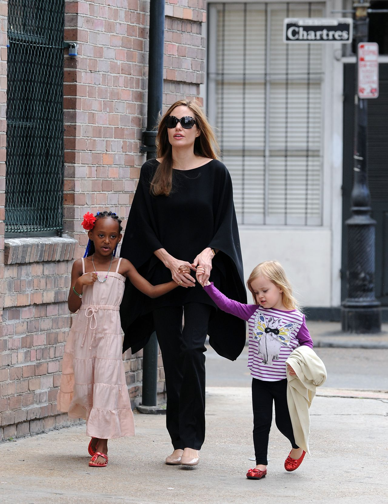 March 11, 2012 - New Orleans, Lousiana USA: Angelina Jolie takes some of her children, Pax, Zahara and Vivienne, out for a stroll in the French Quarter. (Andrea Renault/POLARIS) *** Local Caption *** 04045485