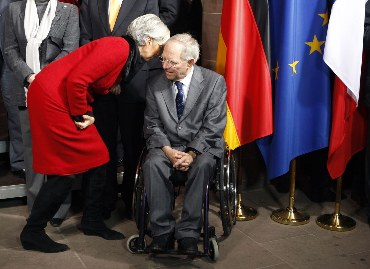 French Finance Minister Christine Lagarde talks to her German counterpart Wolfgang Schauble, during a group photo of a German-French consultations at the city hall in Freiburg, southern Germany, Friday, Dec.10, 2010.(AP Photo/Michel Euler)