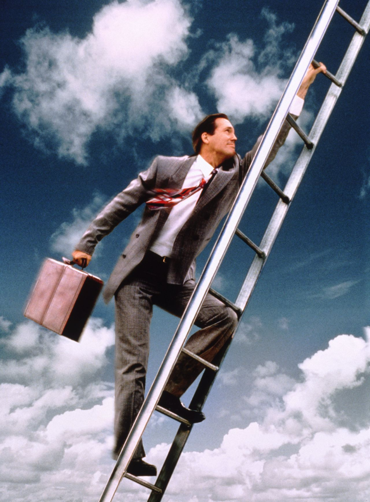 --- Climbing the corporate ladder --- Image by © Tom & Dee Ann McCarthy/CORBIS